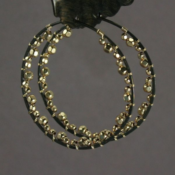 black and gold beaded hoops