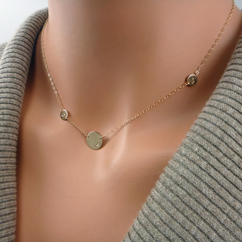 asymmetrical initial necklace one large disc and two tiny discs