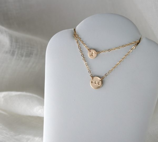 double layered initial necklace with small and medium disc