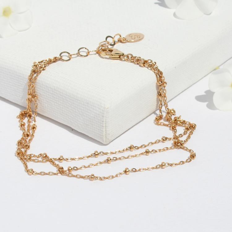 triple layered gold beaded chain bracelet
